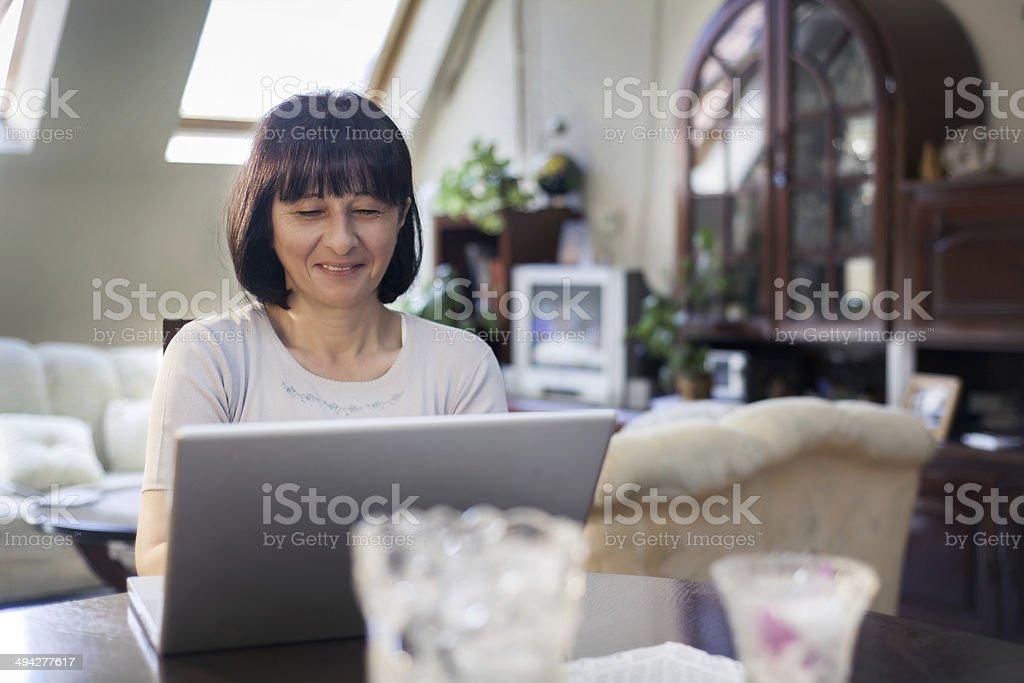 Senior woman working on computer stock photo