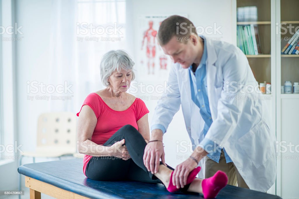 Senior Woman Working with a Physical Therapist stock photo