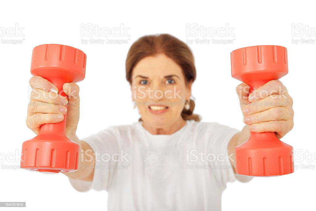 Senior woman working with dumbbell stock photo