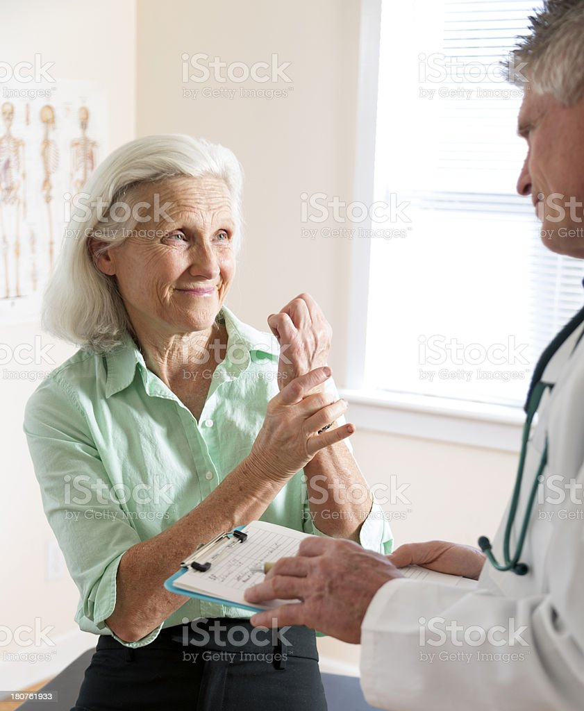 Senior Woman's Doctor Visit stock photo