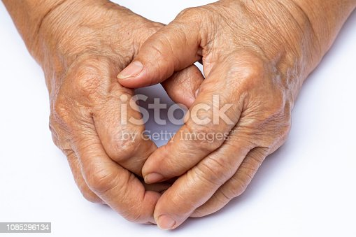 istock Senior woman's grasping her hands, wrinkled skin texture of blood in back of the hands on white background , Close up & Macro shot, Selective focus, Asian body skin part, Healthcare concept 1085296134