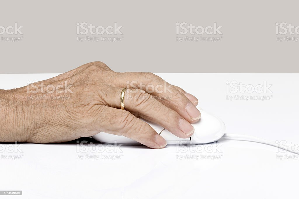 Senior woman's hand on a mouse royalty-free stock photo