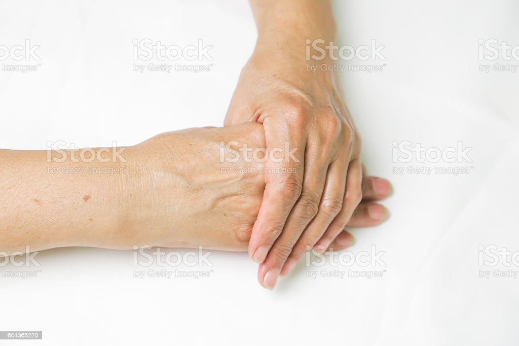 Senior woman's hands isolated on white stock photo