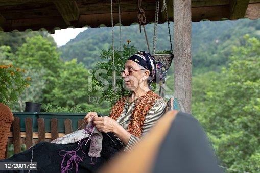 Senior woman's hands knitting