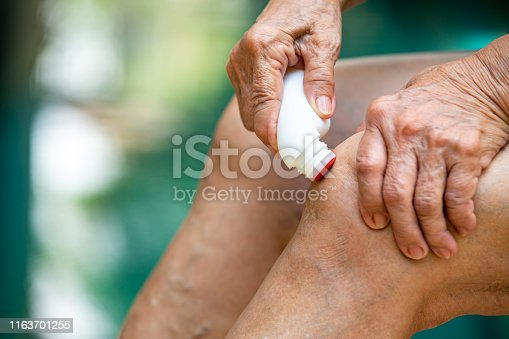 1133511905istockphoto Senior woman's hands massaging her knee, Using analgesic liquid, muscle pain reliever roll on medicine, Blue swimming pool background, Close up & Macro shot, Selective focus, Asian Body skin part, About Massage, Healthcare concept 1163701255
