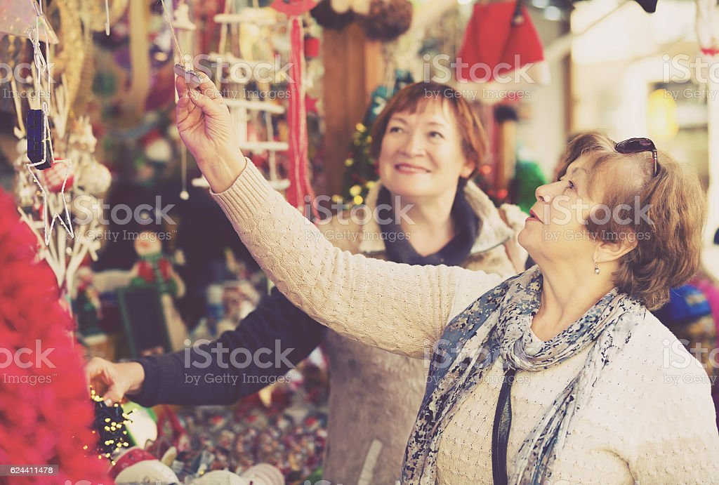 Senior women at Christmas market stock photo