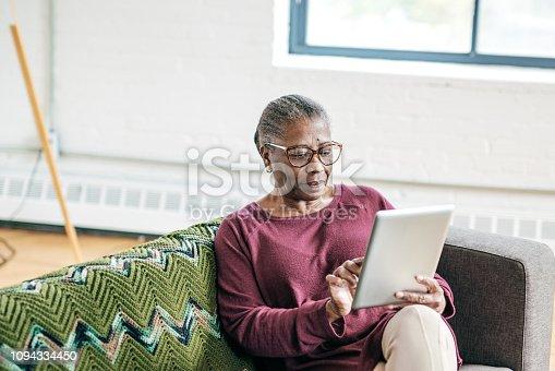 Senior women using tablet for smart home application
