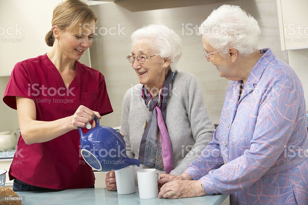 Senior women at home with carer royalty-free stock photo