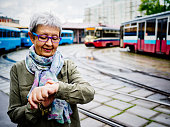 Beautiful woman 74 years old ar tram station