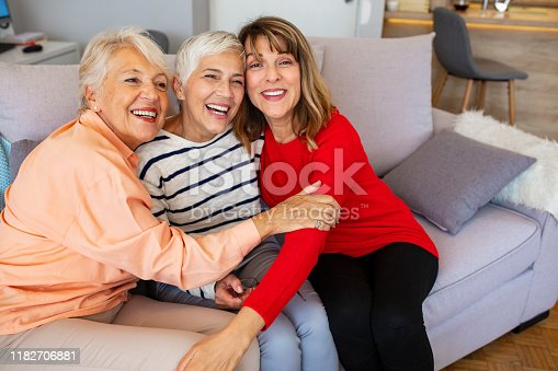 1053414472istockphoto Senior women, best friends, laughing 1182706881