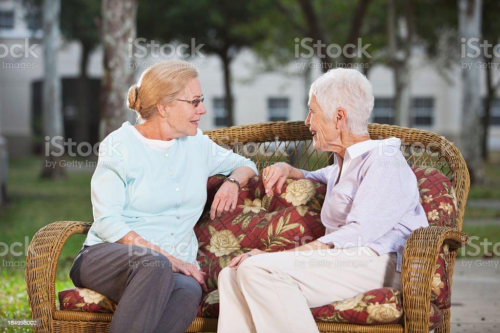 Senior women chatting on patio royalty-free stock photo