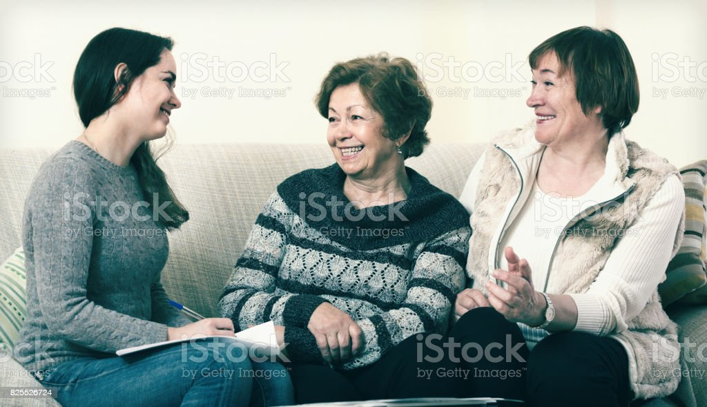 Senior women consulting with banking agent stock photo