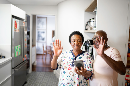 Senior Women Doing A Video Call Using Smartphone Stock Photo - Download Image Now