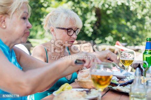 istock Senior women eating lunch outdoors 826652778