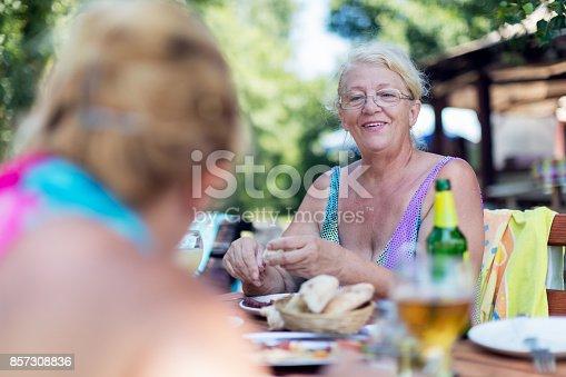 istock Senior women eating outdoors 857308836