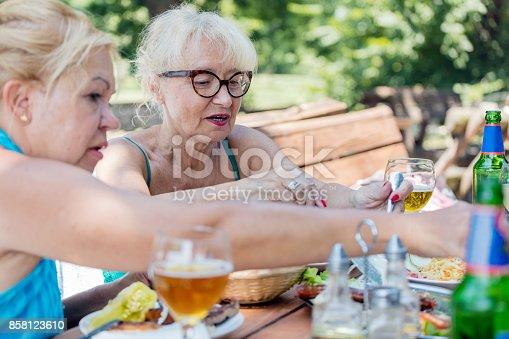 istock Senior women eating outdoors 858123610