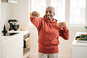 istock Senior women exercising at home 1218115713