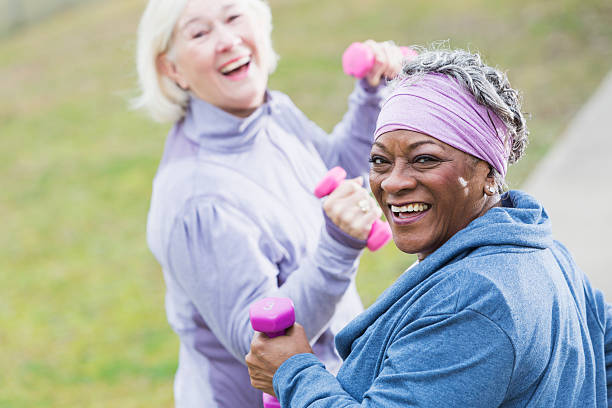 senior women exercising - 60 69 years stock photos and pictures