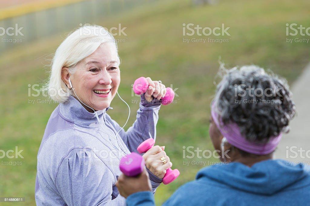 Senior women exercising stock photo