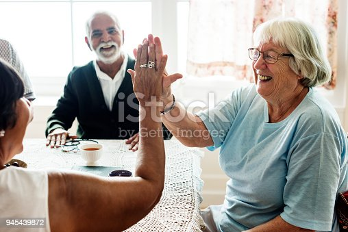 istock Senior women giving each other high five 945439872