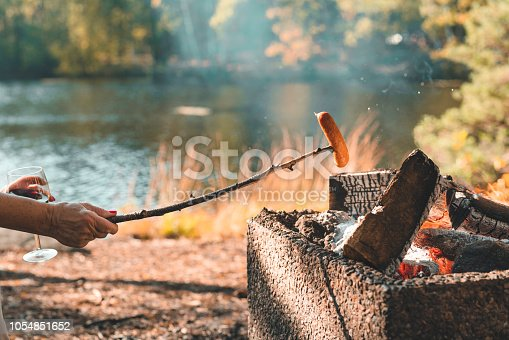Two senior Eastern European women are having a barbecue picnic in a Swedish forest on a beautiful autumn day.