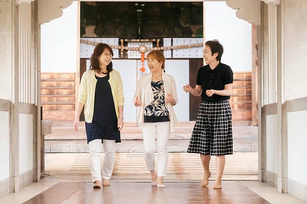 Senior Women in Buddhist Temple stock photo