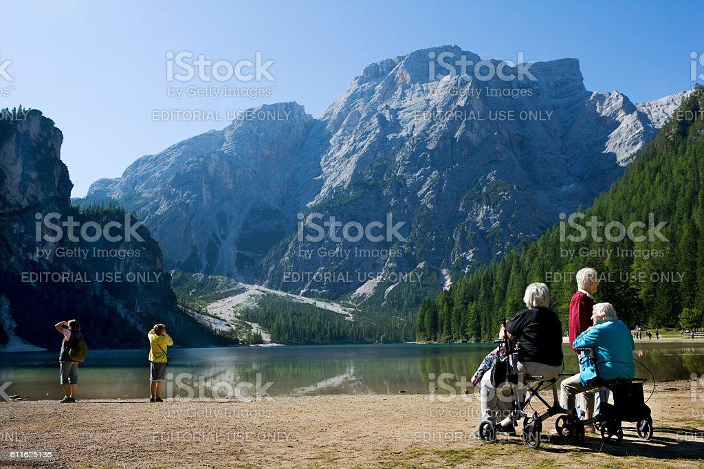 senior women in scenic mountain landscape of Dolomite Alps stock photo
