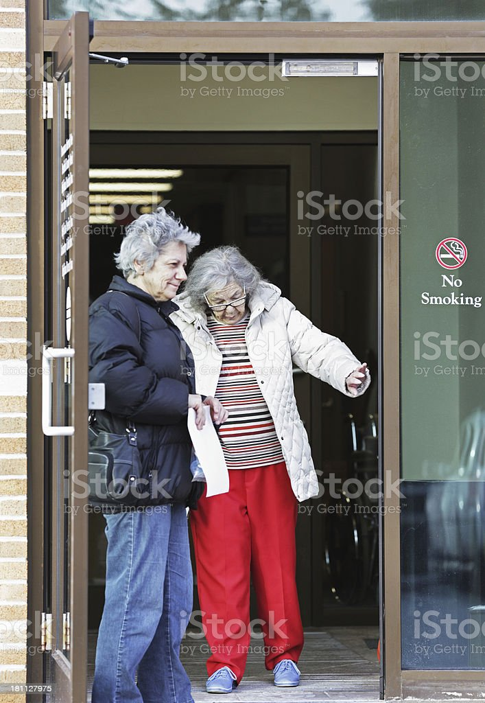 Senior Women Leaving Doctor's Office royalty-free stock photo