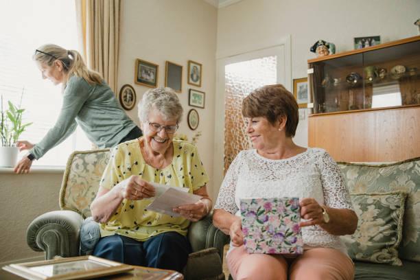 Senior Women Looking at Photo Albums stock photo