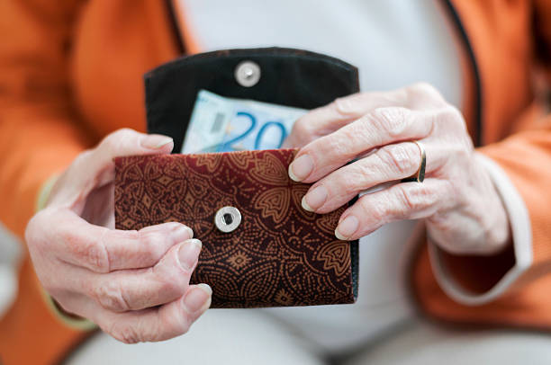 Senior women looks in her purse stock photo