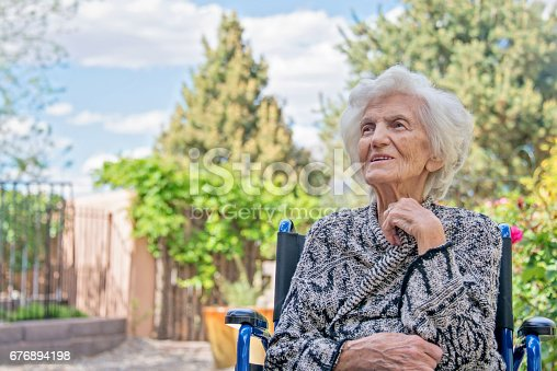 istock Senior Women Lost in Thoughts in Wheel Chair 676894198