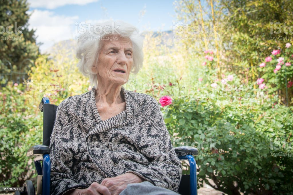 Senior Women Lost in Thoughts in Wheel Chair royalty-free stock photo