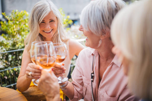 senior women on holidays toasting with wine during wine tasting - vacations food stock pictures, royalty-free photos & images