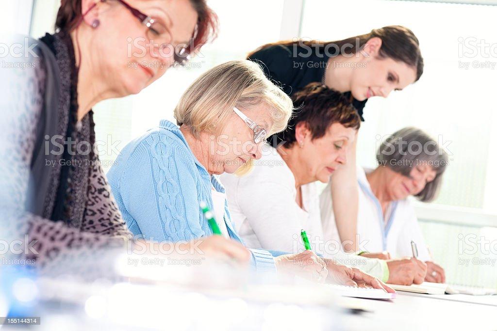 Senior women on the seminar royalty-free stock photo