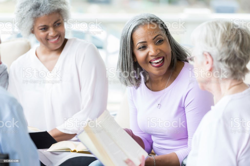 Senior women participate in book club stock photo