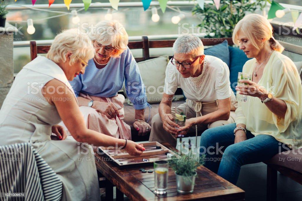Senior Women Playing Backgammon stock photo