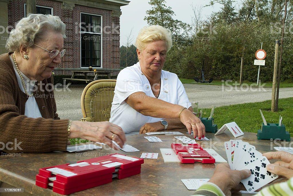 Senior women playing bridge royalty-free stock photo