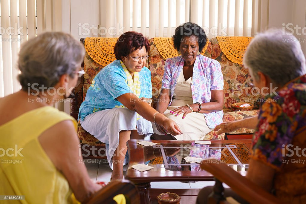 Senior Women Playing Card Game In Hospice stock photo