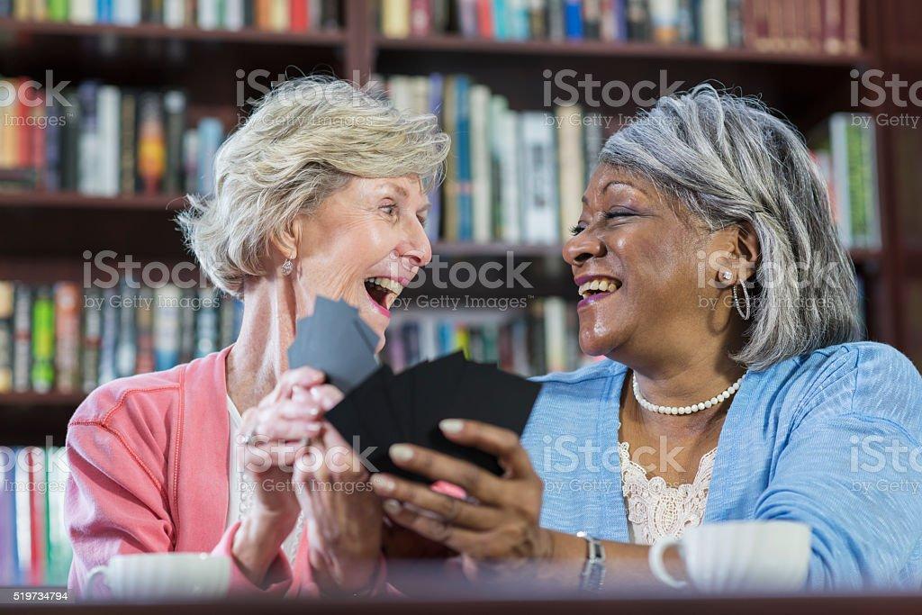 Senior women playing card game stock photo