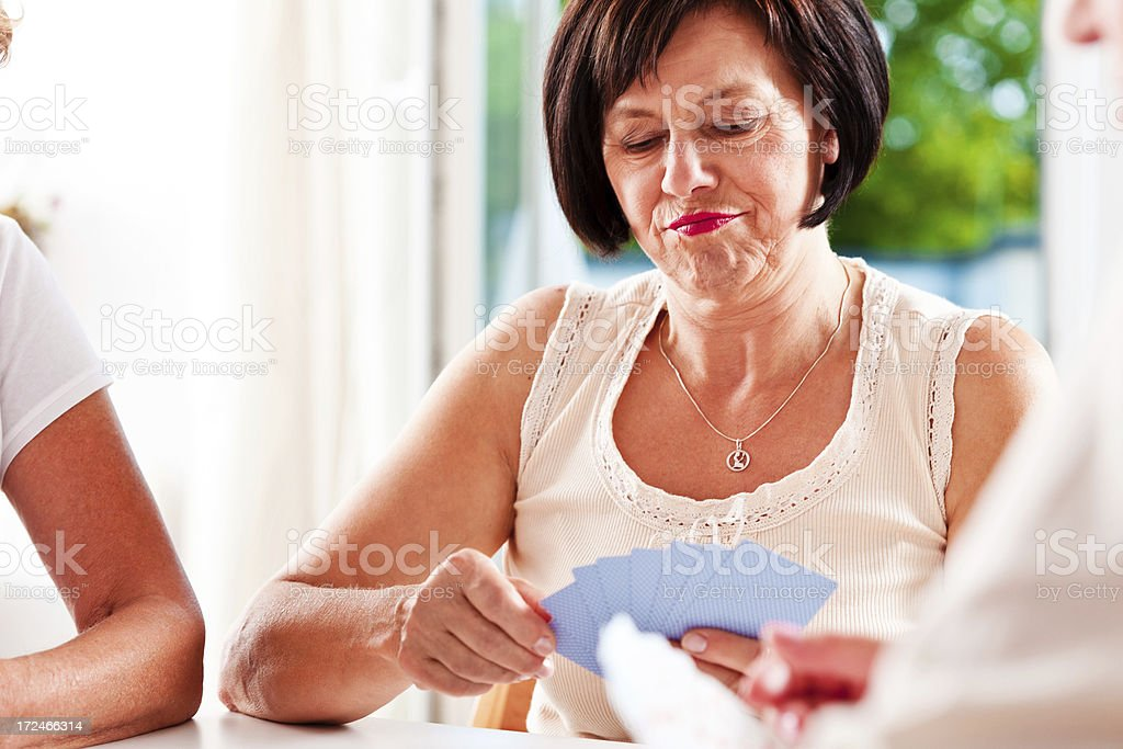 Senior women playing cards stock photo
