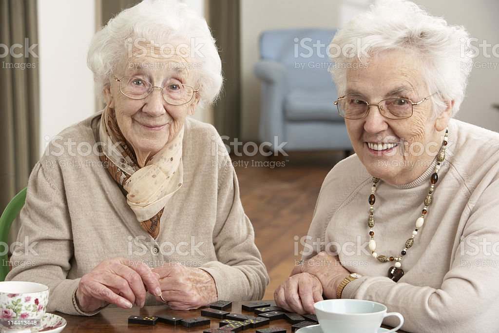 Senior Women Playing Dominoes At Day Care Centre royalty-free stock photo