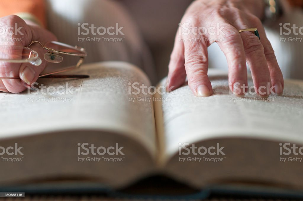 Senior women reading a book stock photo