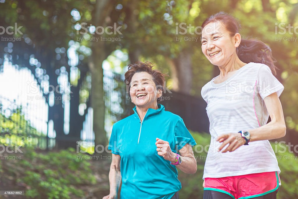 Senior women running in Yoyogi park stock photo