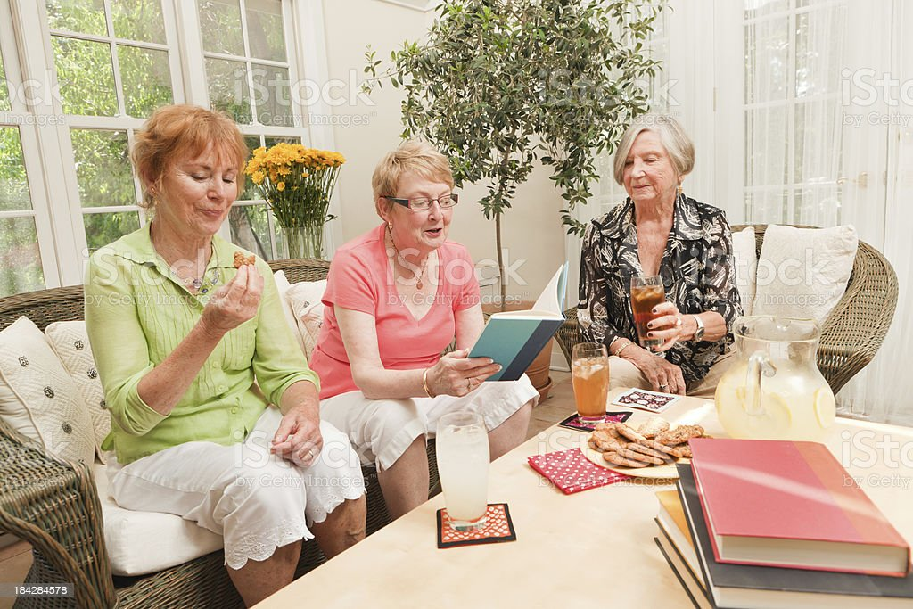 Senior Women Social Gathering Reading in Book Club Hz stock photo