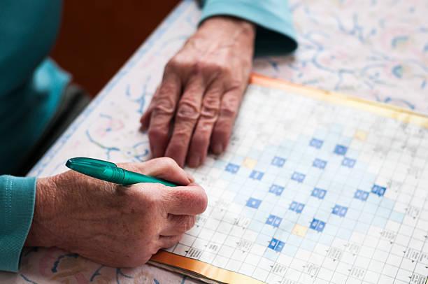 Senior women solve crosswords stock photo