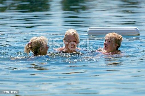 istock Senior women swimming in lake 828408356