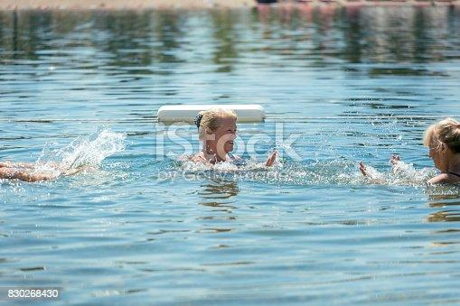 istock Senior women swimming in lake 830268430