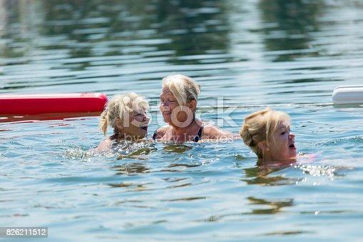 istock Senior women swimming 826211512