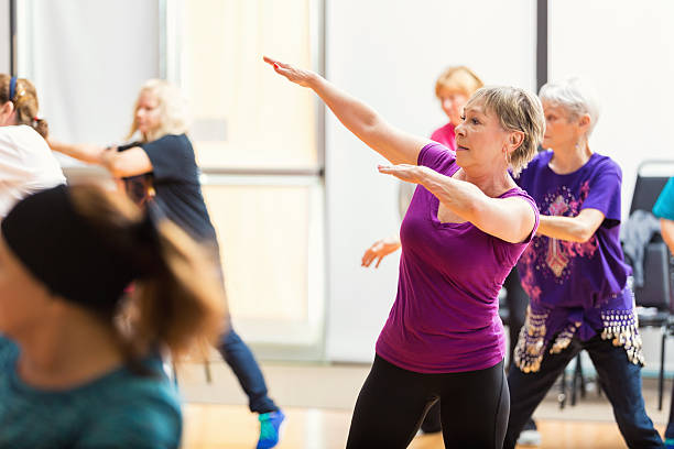 senior women take dance lessons - dance class stock photos and pictures