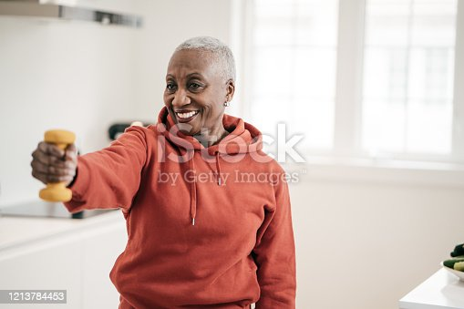 istock Senior women taking care of herself  she exercise with  dumbbells at home 1213784453